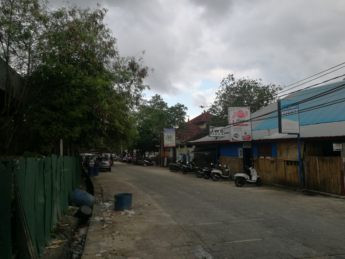 indonesia bali jimbaran street trashy scooter